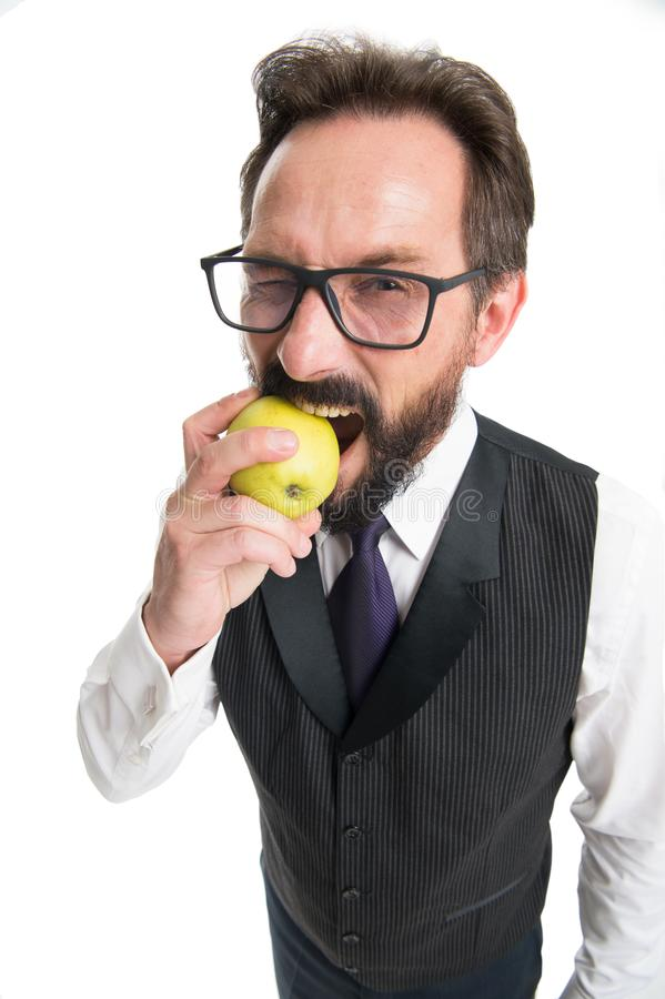 Businessman classic formal clothing and eyeglasses hold eat apple. Healthy vision sight nutrition tips. Best foods for. Eye health. Eye health concept. Tips eye stock photography