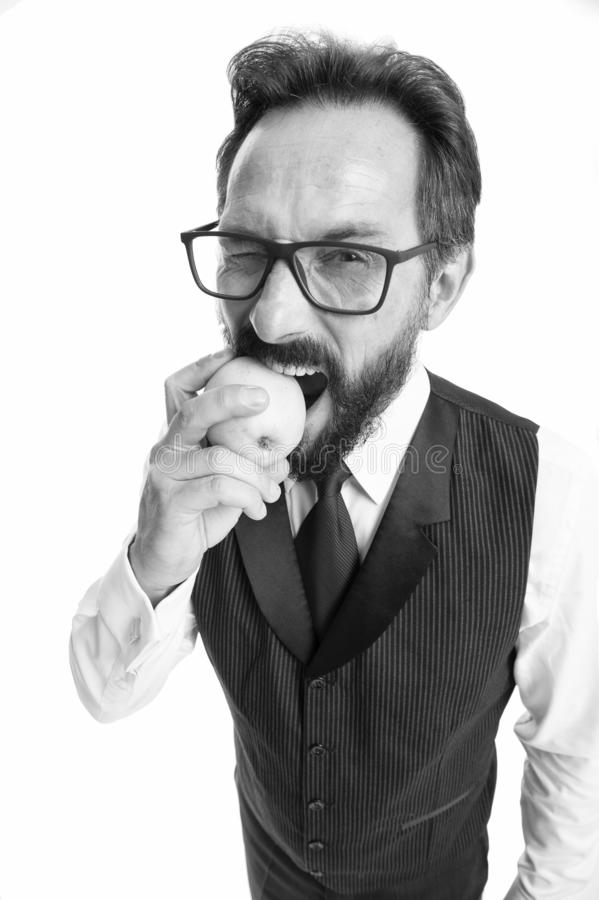 Businessman classic formal clothing and eyeglasses hold eat apple. Healthy vision sight nutrition tips. Best foods for. Eye health. Eye health concept. Tips eye royalty free stock photography