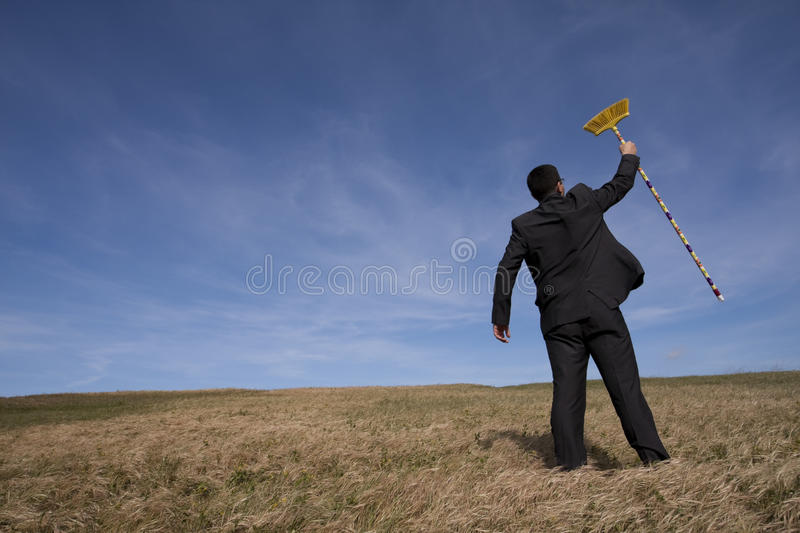 Businessman cleaning the environment royalty free stock photos