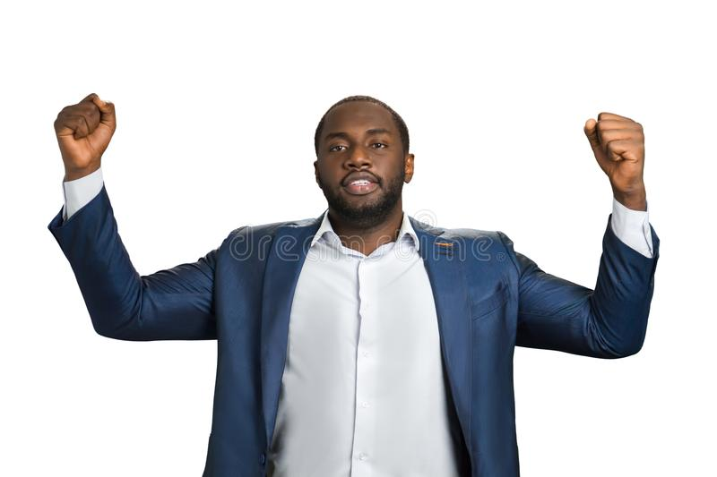Businessman clenching raised fists. royalty free stock image