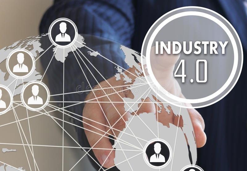 The businessman clicked the button industry 4.0. On the touch screen royalty free stock image