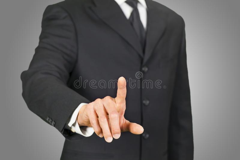 Businessman clicking on touch screen. With finger royalty free stock image