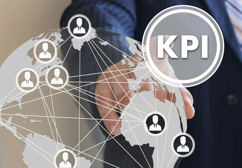 The businessman clicks the button KPI royalty free stock image