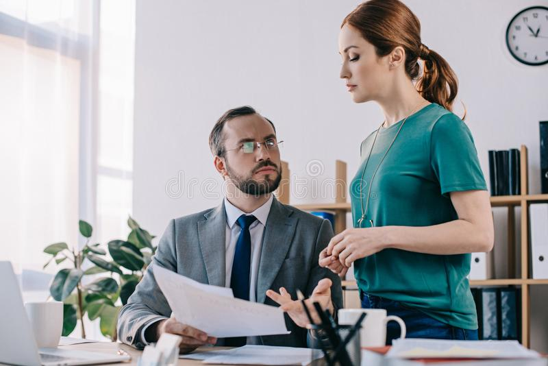 businessman and client discussing contract during meeting royalty free stock photography
