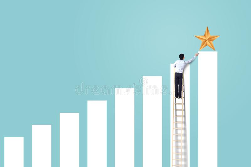 Businessman climb up rising graph on ladder to reach star, successful and win concept. Businessman climb up rising graph on ladder to reach star stock images