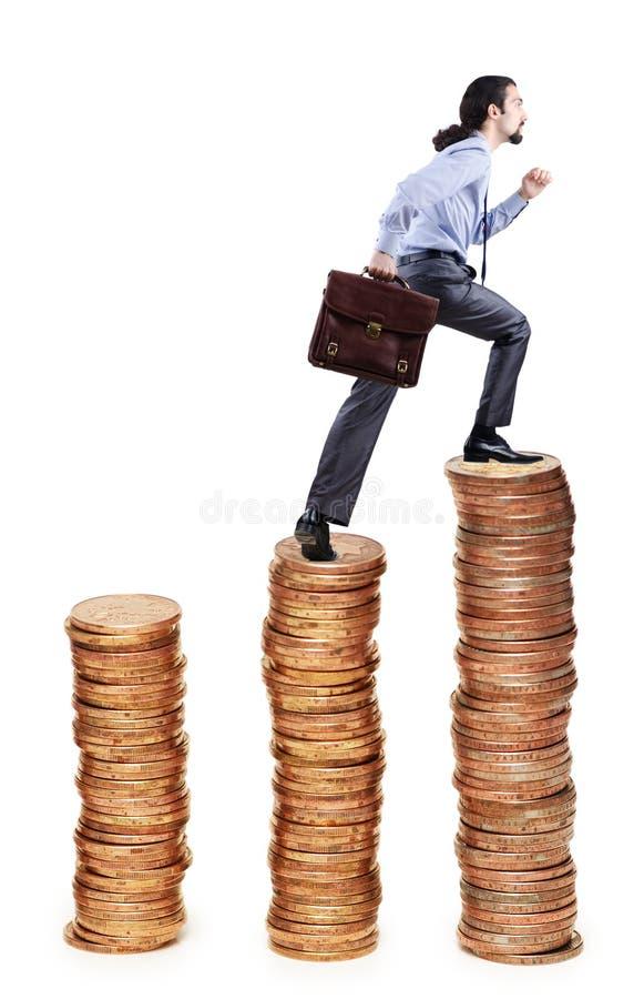 Businessman Climbing  Coins Stacks Royalty Free Stock Photo