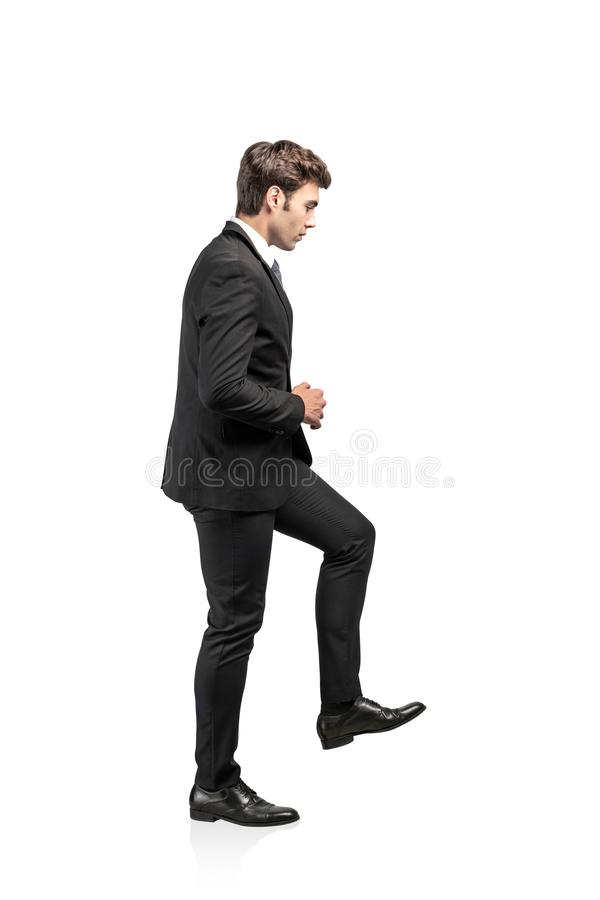 Businessman climbing imaginary stairs, success royalty free stock photos