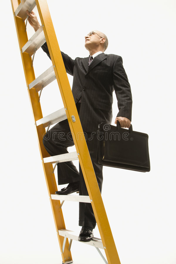 Businessman climbing ladder. stock images