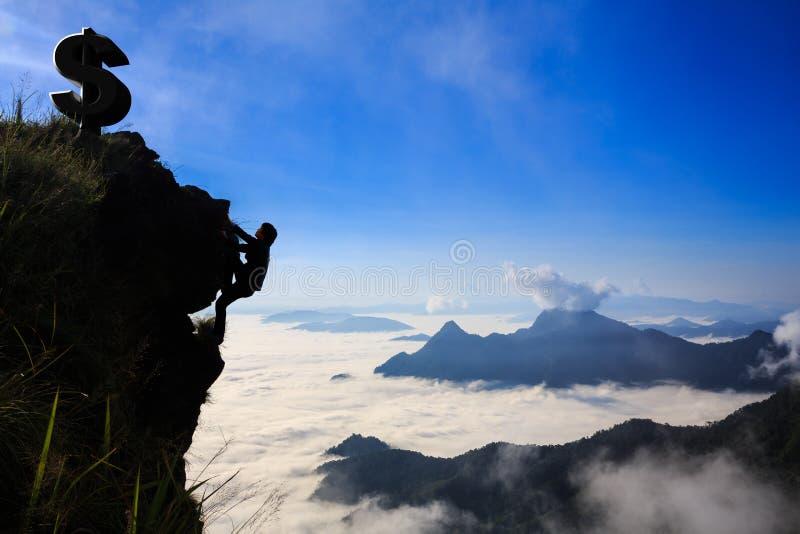 Businessman climbing a mountain. Business success concept stock images