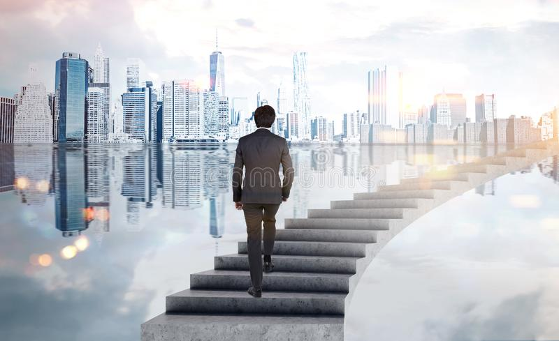 Businessman climbing stairs in city stock photos