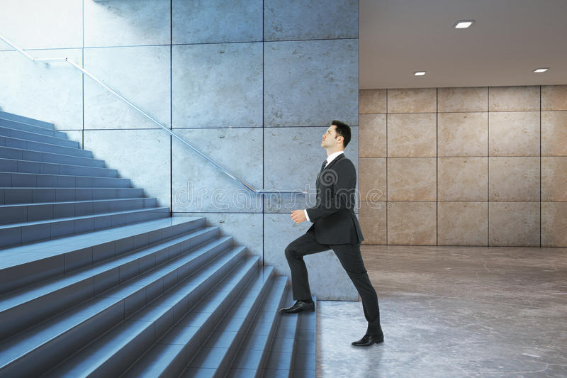 Businessman climbing success stairs side. Success concept. Businessman climbing illuminated underground staircase with `way out` sign. Side view, 3D Rendering stock images
