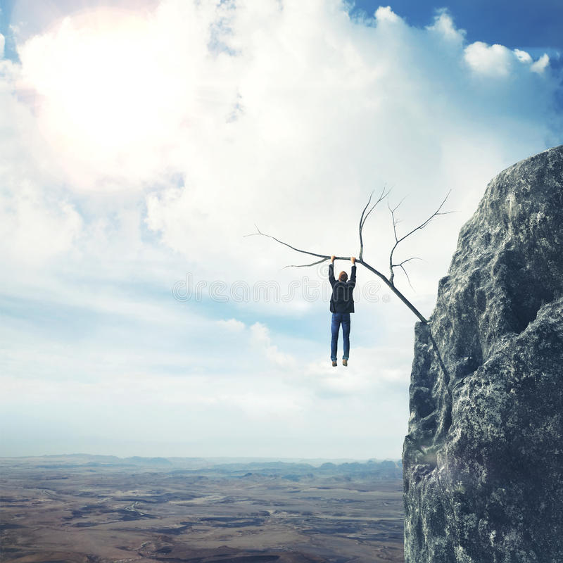 Businessman climbs a mountain royalty free stock images