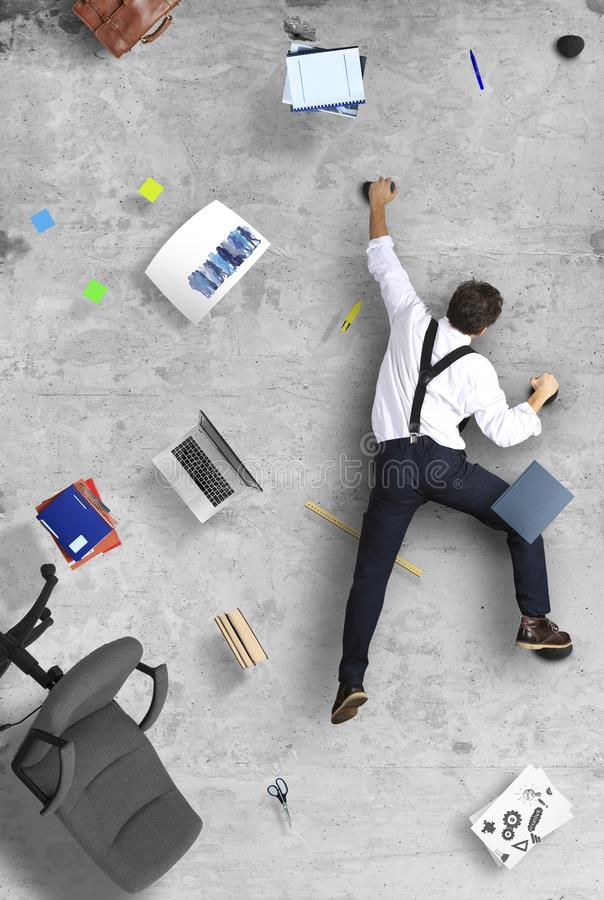 Businessman climbs the wall as a climber royalty free stock images