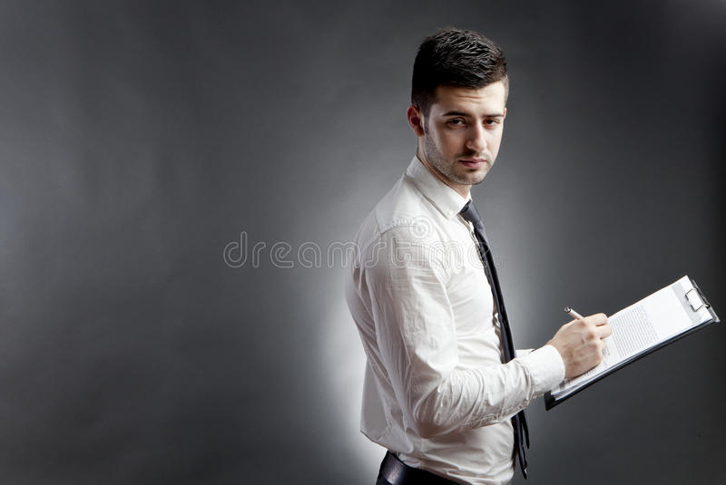 Download Businessman with clipboard stock image. Image of single - 25472859