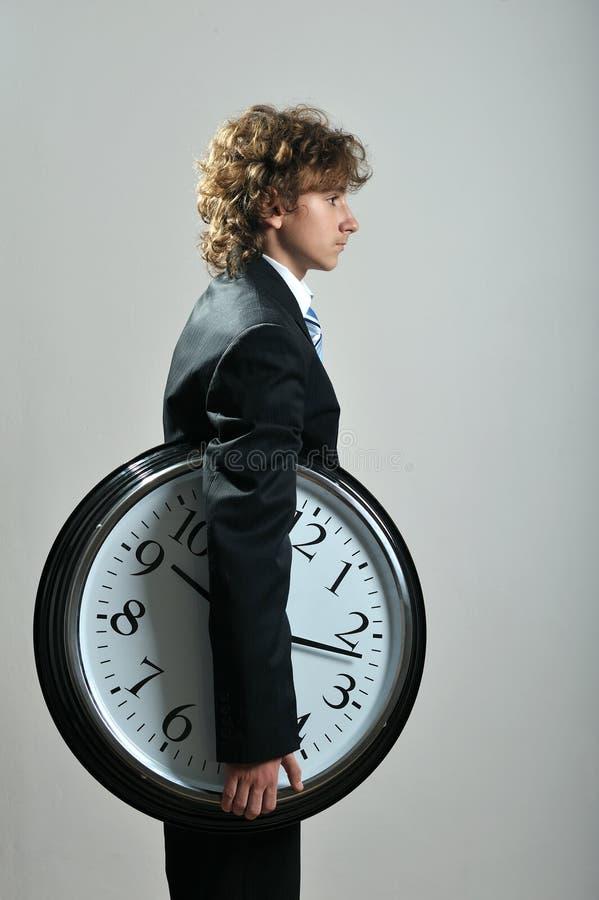 Businessman and clock