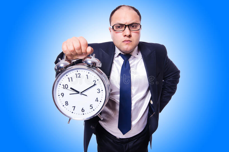 Businessman with clock. On white stock photo