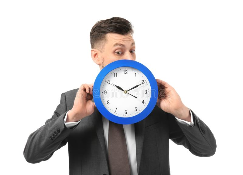 Businessman with clock on white background. Time management concept stock image