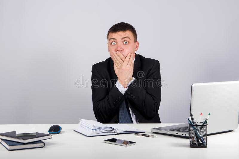 Businessman closing mouth with hands. Shut up. Office, finances, internet, business, success and people concept-Businessman closing mouth with hands. Shut up stock photos