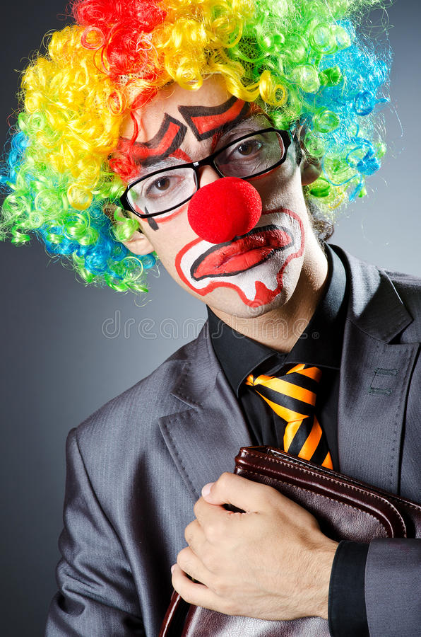 Businessman with clown wig