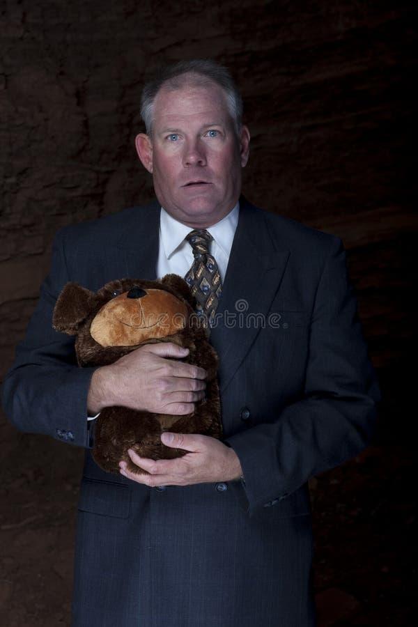 Businessman Clutching a Teddy Bear