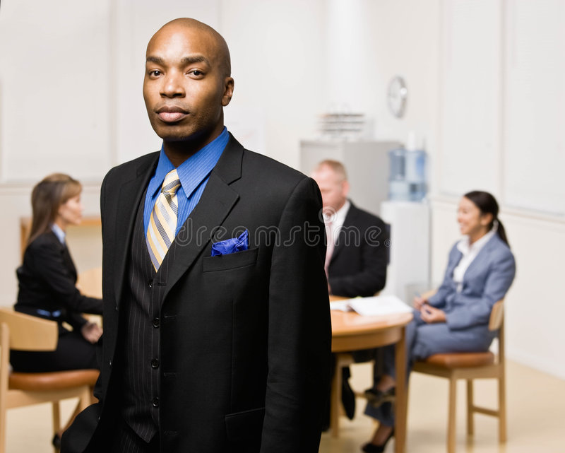 Businessman With Co-workers In Background Royalty Free Stock Images