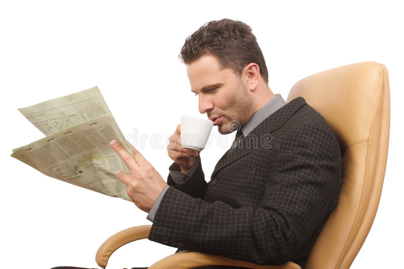 Businessman,coffee,newspaper. Resting businessman drinking coffee and reading newspaper , sitting on the chair - isolated royalty free stock photos
