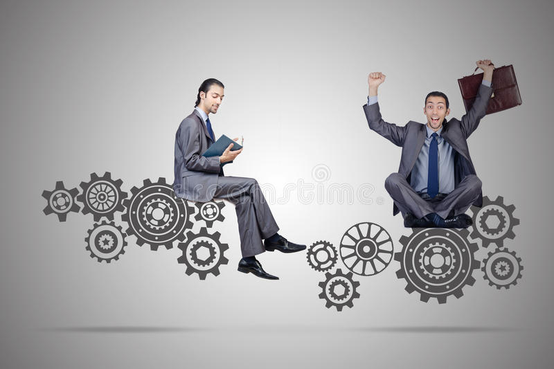The businessman with cogwheels gear in teamwork concept. Businessman with cogwheels gear in teamwork concept royalty free stock photos