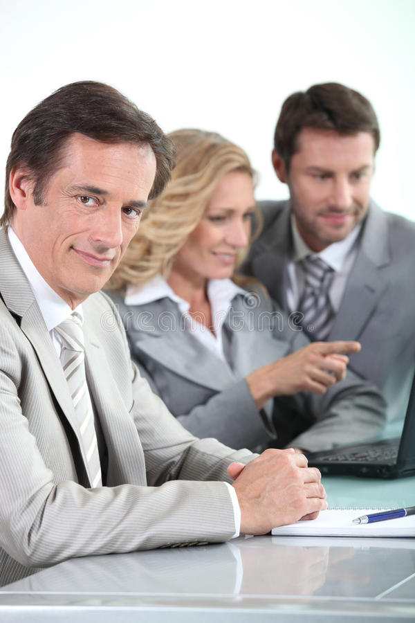Download Businessman and colleagues stock photo. Image of desk - 22920056