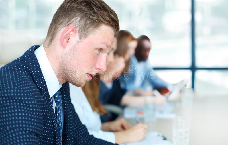 Businessman. With colleagues in the background royalty free stock photo