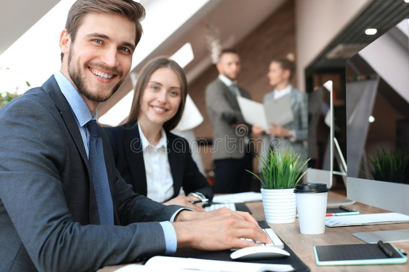 Businessman with colleagues in the background in office. royalty free stock photography