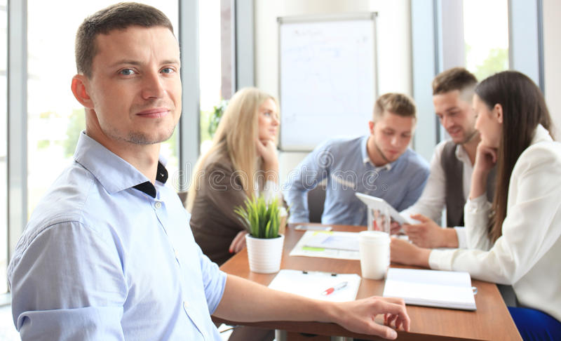 Businessman with colleagues stock photos