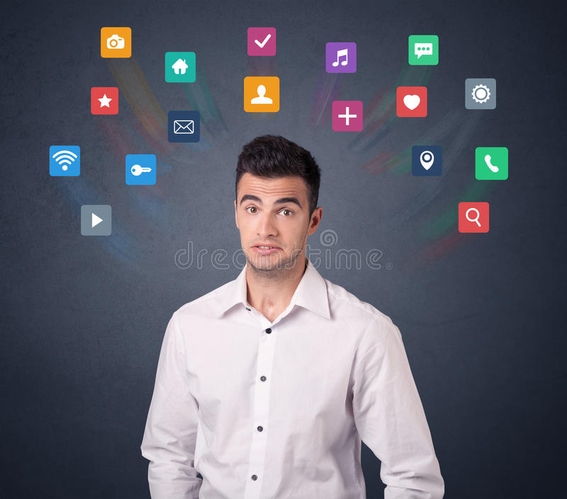 Businessman with colorful apps. Young casual businessman with colorful applications over his head royalty free stock image