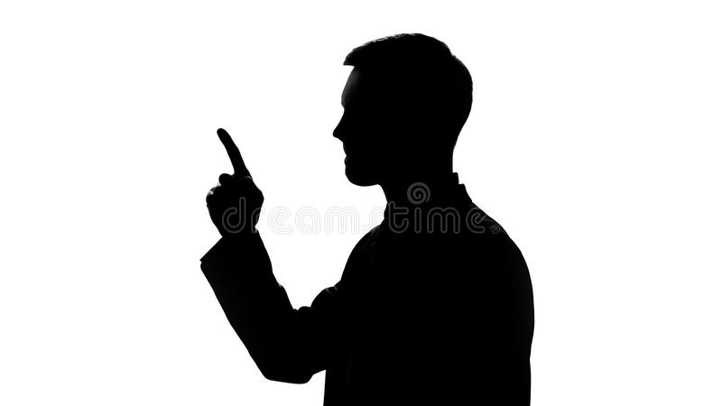 Businessman comes up with idea, male silhouette recollects important information stock photography