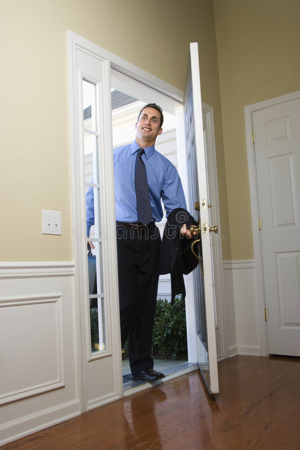 Businessman coming home. stock photo