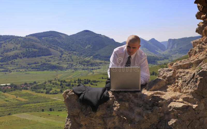 Businessman On A Computer Outdoors Stock Photos
