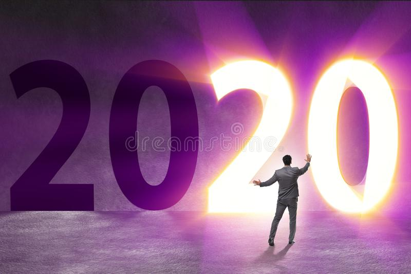 Businessman and concept of new year 2020. The businessman and concept of new year 2020 stock photography