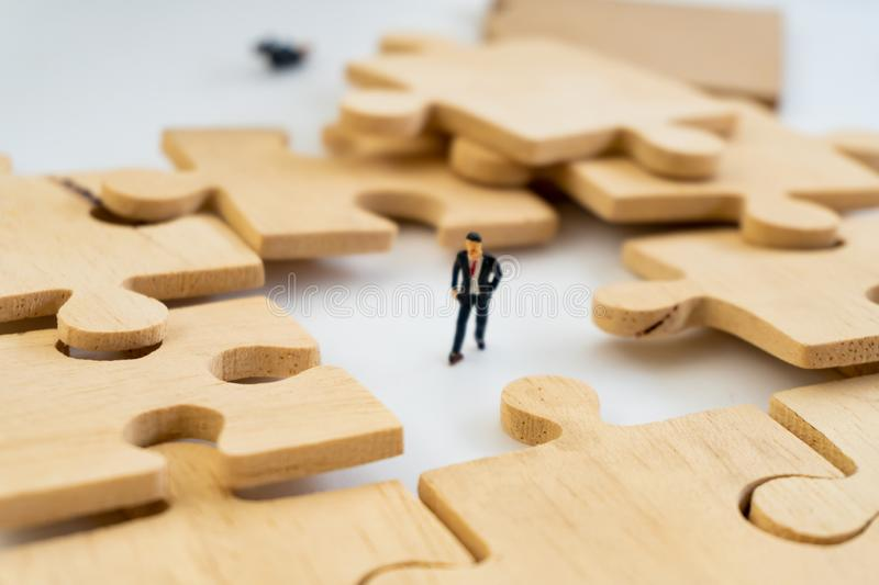 Businessman concept sit on the jigsaw puzzle meaning of key success. Figuring concept royalty free stock images