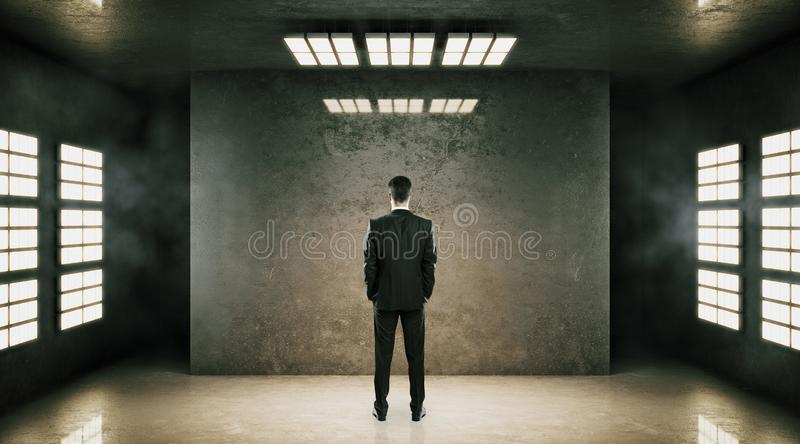 Businessman in concrete interior royalty free stock photography