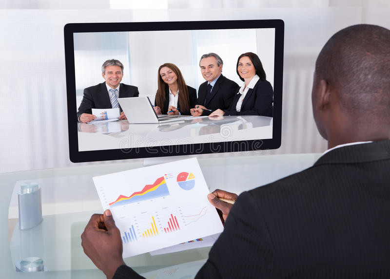 Businessman in conference analyzing graph royalty free stock image