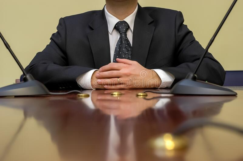 Businessman at conference table stock photo