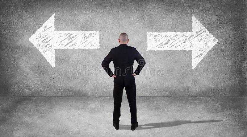 Businessman Confuse to Choose Direction stock photos