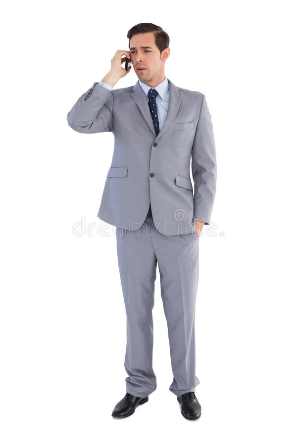 Download Businessman Confused While Being On The Phone Stock Photo - Image of classy, standing: 30882522