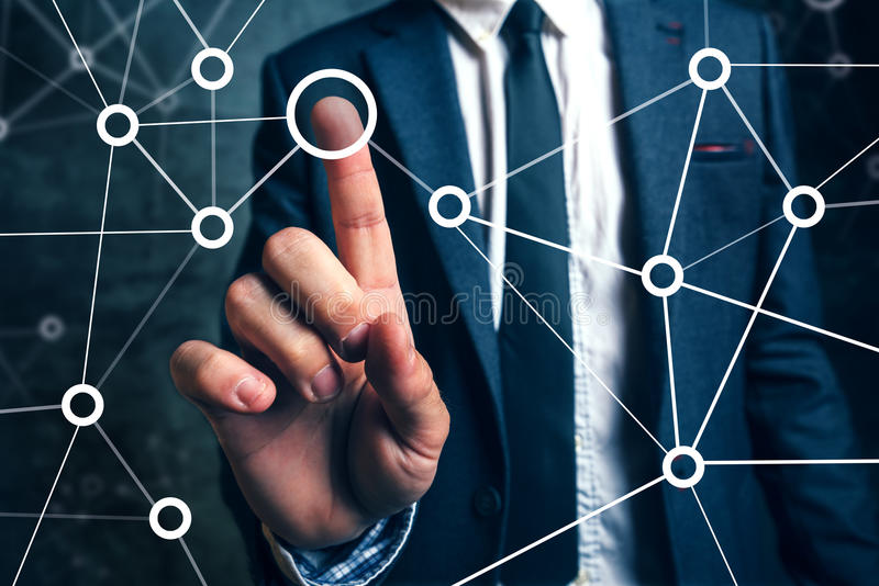 Businessman connecting the dots in business project management. Social networking or teamwork organization royalty free stock photography