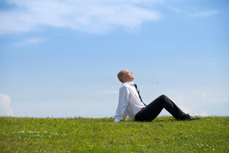 Businessman contemplating in park royalty free stock photos