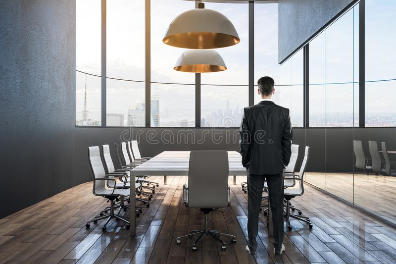 Businessman in contemporary conference room stock photography