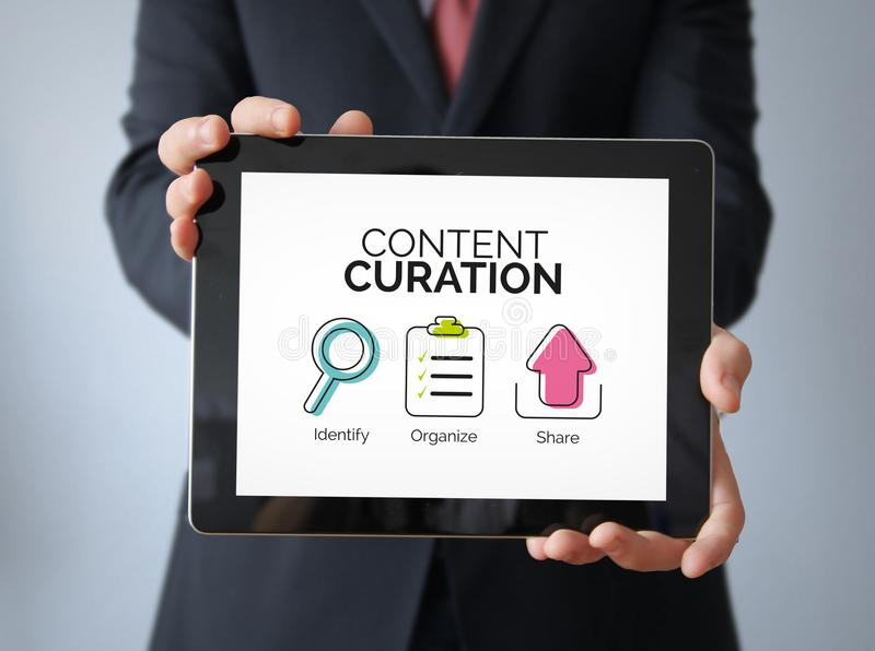 businessman with content curation concept on a tablet stock images