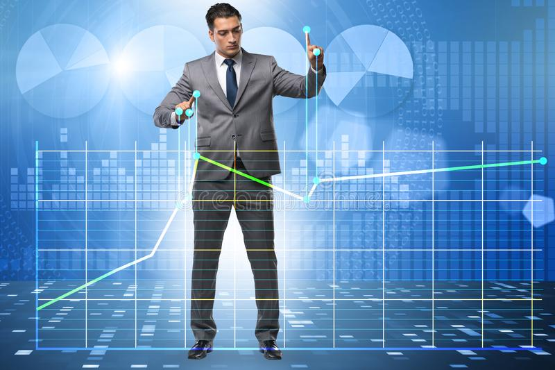 Businessman controlling the market with strings. The businessman controlling the market with strings stock photos