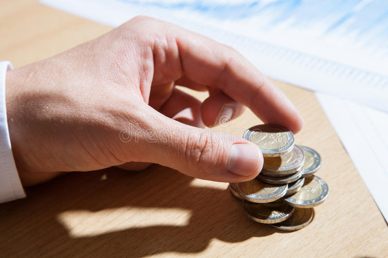 Businessman counting euro coins. Closeup shot royalty free stock images