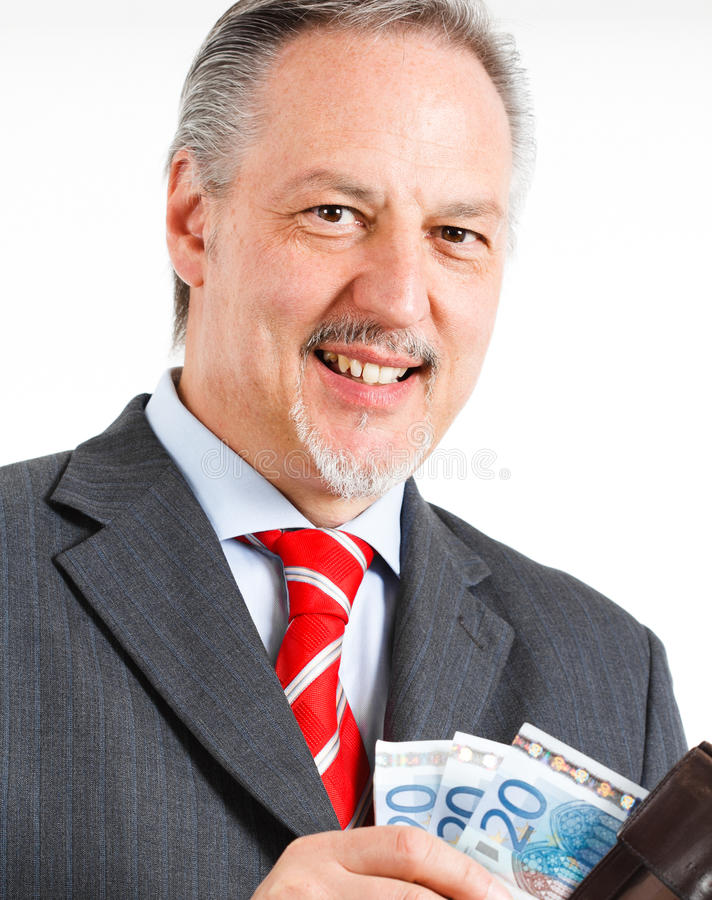 Businessman counting money royalty free stock image