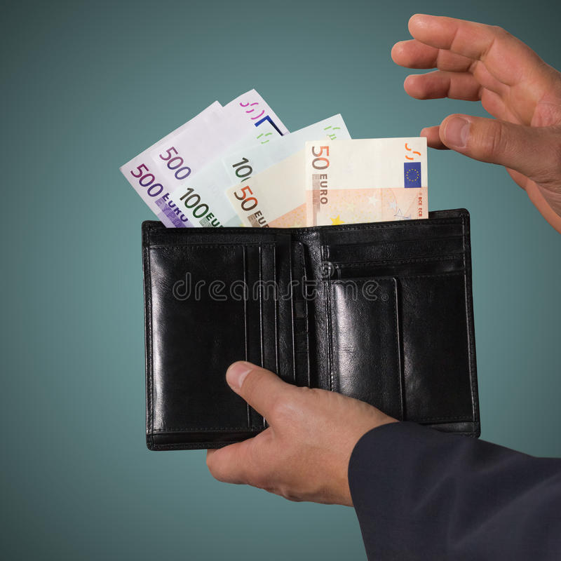 Businessman counts money stock photos